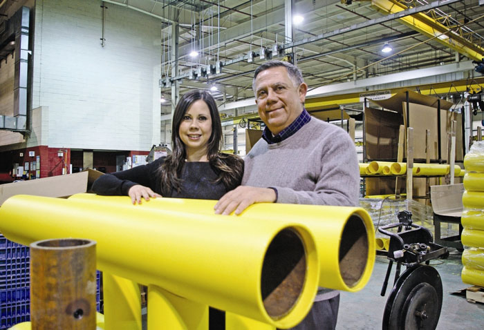 Ideal Steel's Frank Venegas and Linzie Venegas with a piece of guardrail