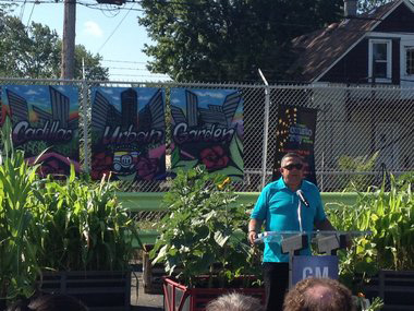 Frank Venegas giving a speech at the Cadillac Urban Gardens in Southwest Detroit