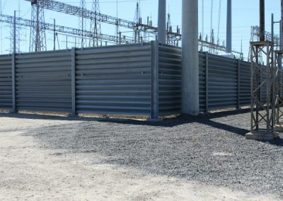 Ideal Utility Services steel ballistic barrier protecting a large electric substation. The barrier was fabricated by Ideal Steel.