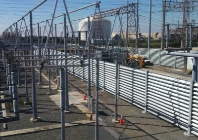 Ideal Utility Services steel ballistic barrier protecting a large electric substation. The barrier was fabricated by Ideal Steel