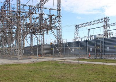Ideal Utility Services custom made steel ballistic barrier protecting a large electrical substation. The barrier was fabricated by Ideal Steel.