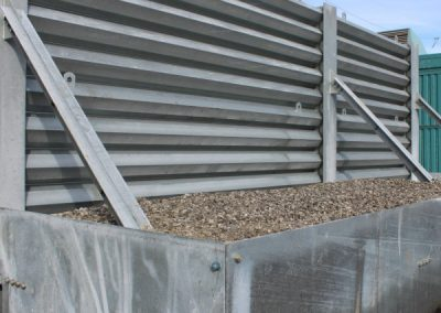 Ideal Utility Services custom made steel ballistic barrier height extension. The barrier was fabricated by Ideal Steel.