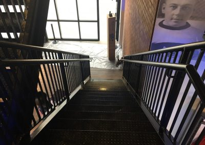 Ideal Steel's black painted stairway at the Team Store inside Little Caesars Arena in Detroit, Michigan
