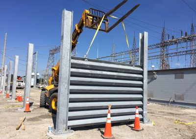 Ideal Utility Services custom made steel ballistic barrier installation. The barrier was fabricated by Ideal Steel.